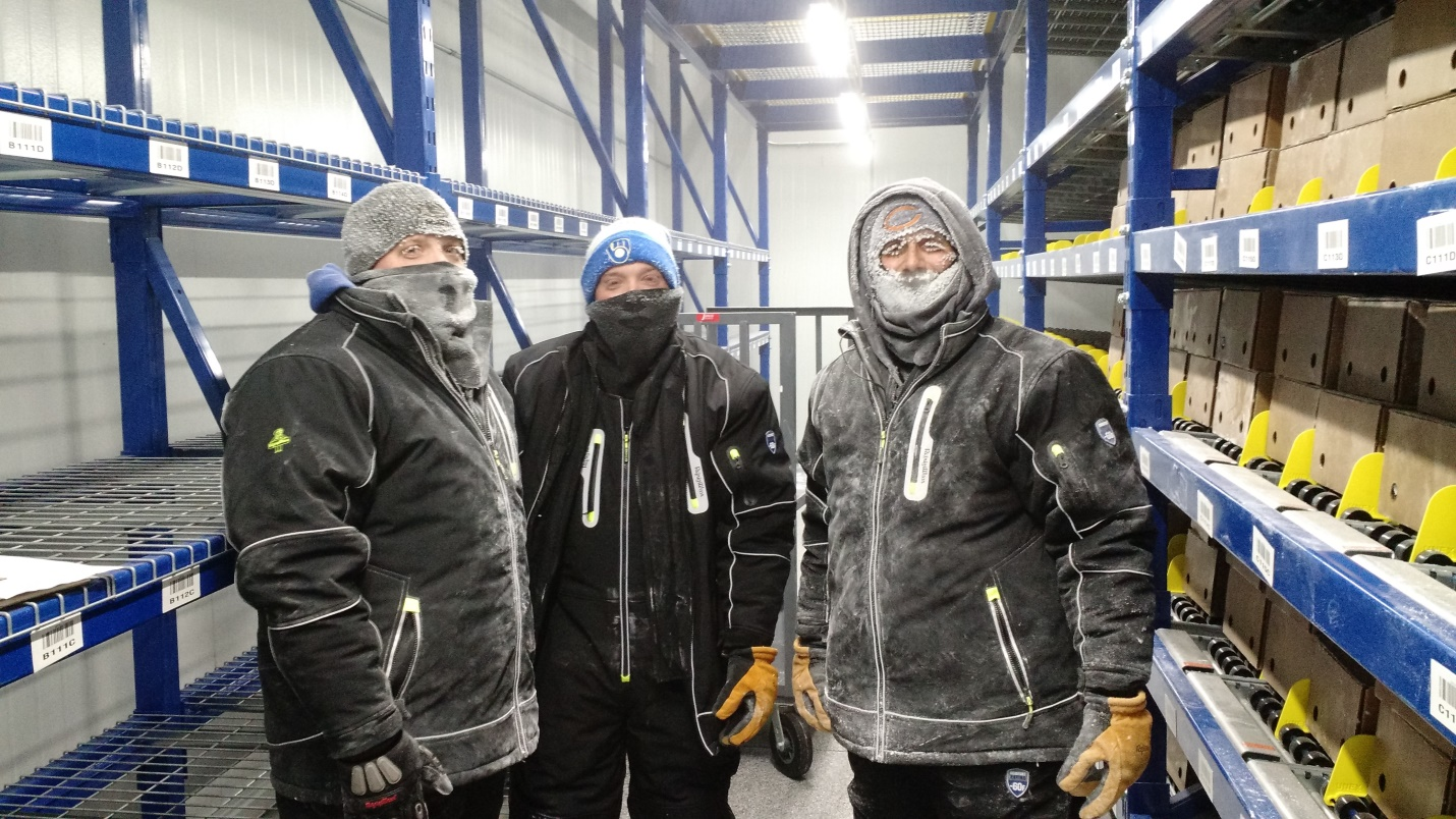CSW employees bundled up in ultra-cold freezer